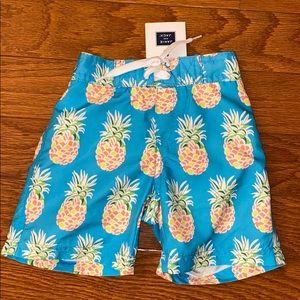 NWT Janie and Jack pineapple swim trunks 12-18m